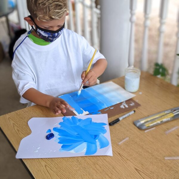 Blonde boy painting