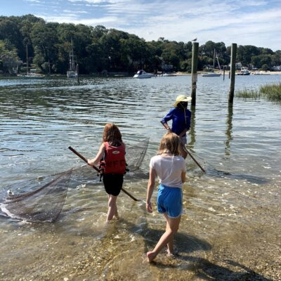 Teacher and 2kids in water with net